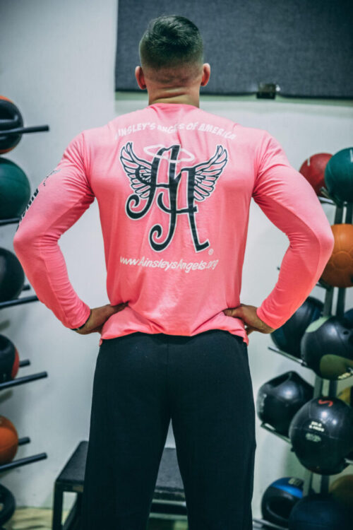 person wearing a pink Ainsley's Angels of America sweatshirt (back view)