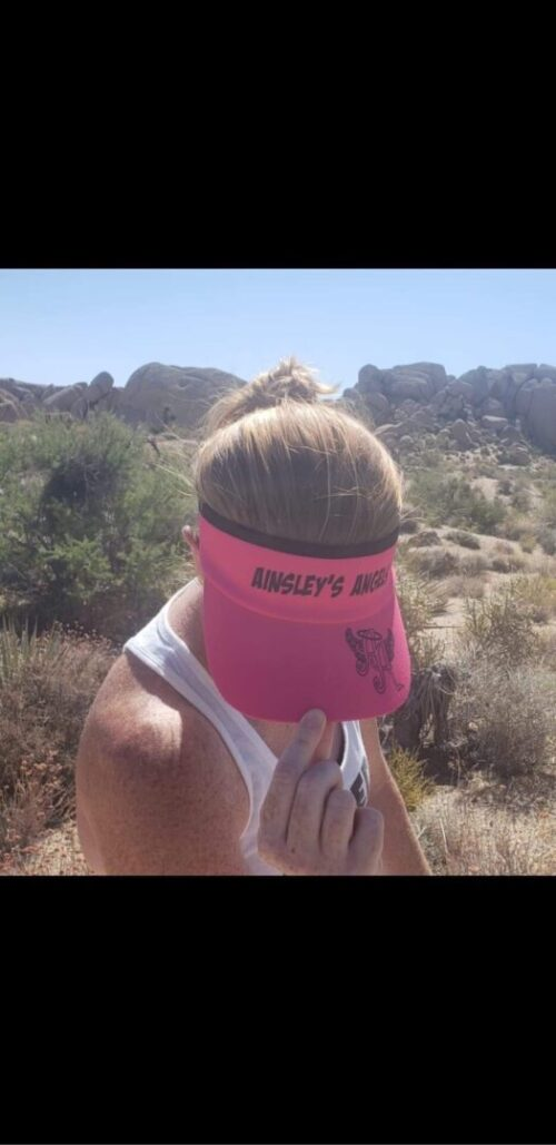 woman showing her Ainsley's Angels of America visor hat