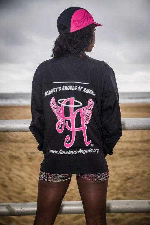 girl wearing black Ainsley's Angels of America zip-up jacket (back view)