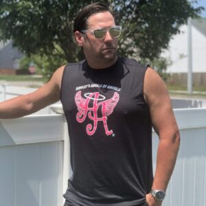 man wearing sunglasses and a black, sleeveless Ainsley's Angels of America shirt