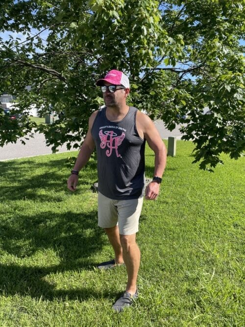 man wearing a gray Ainsley's Angels of America tank top