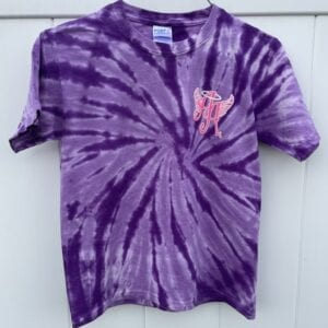 purple tie-dye shirt with Ainsley's Angels of America logo