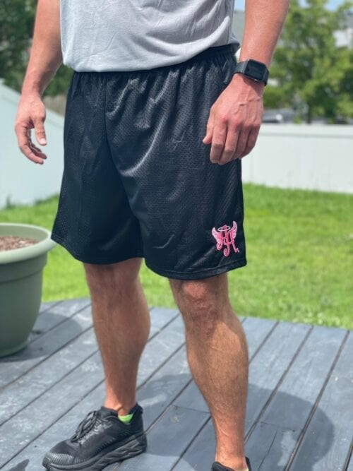 black shorts with Ainsley's Angels of America logo