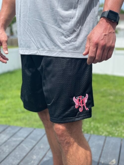 black shorts with Ainsley's Angels of America logo (different angle)
