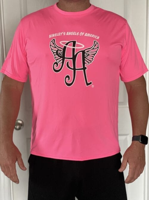 pink shirt with Ainsley's Angels of America's logo in front